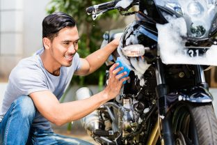 How should you wash your motorbike or scooter?